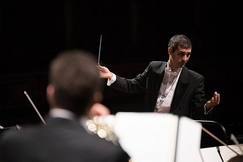 A director holds a baton to direct an orchestra