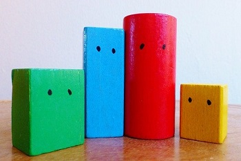 Blocks of different shapes and colors illustrate geometry and Assistive Technology for the Blind